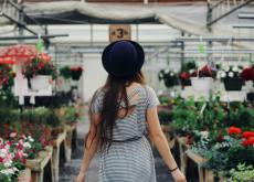 https://www.pexels.com/photo/woman-walking-between-display-of-flowers-and-plants-906006/